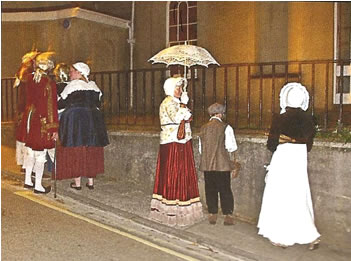 A group of Georgians await the arrival of Nelson outside Foley House during the ghost walks.